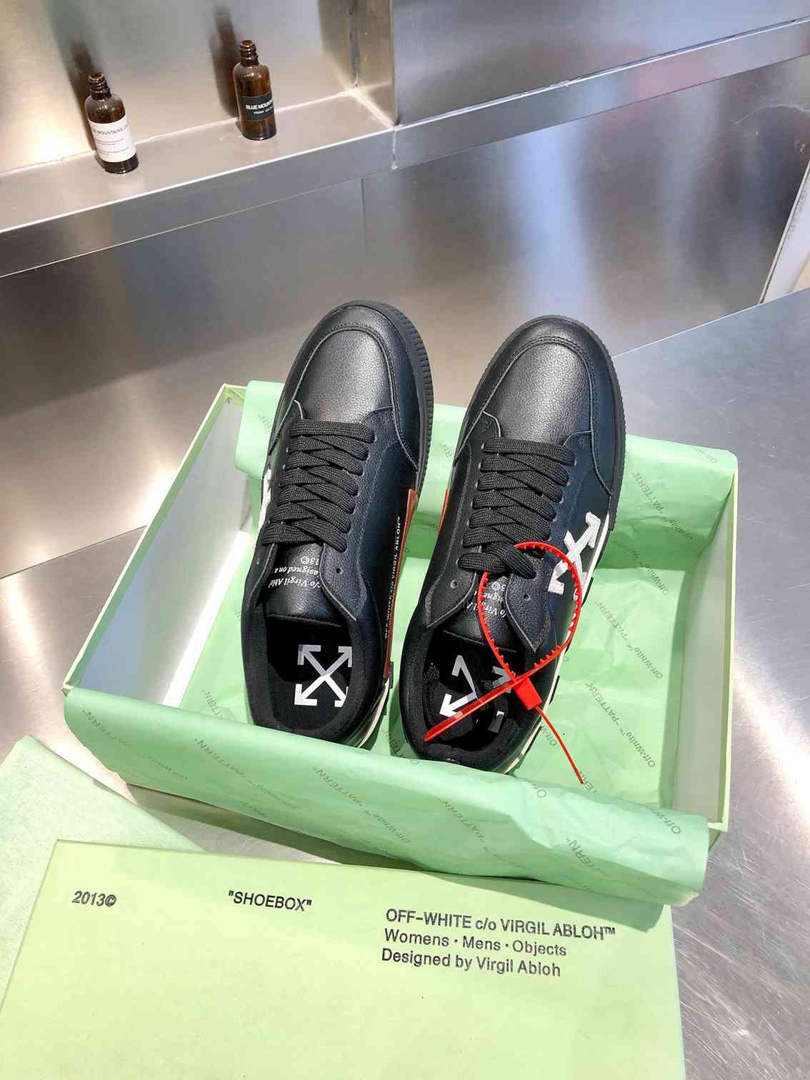 ow sneakers in box
